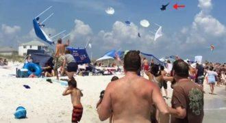 Πολεμικό αεροπλάνο πέταξε χαμηλά σε παραλία και σήκωσε όλες τις ομπρέλες στο αέρα!